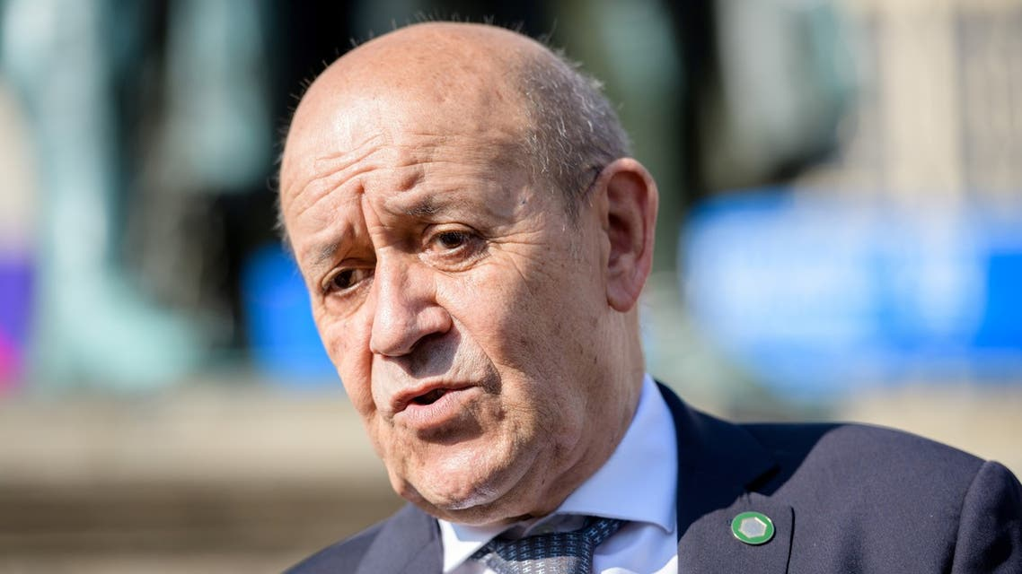 French Foreign Minister Jean-Yves Le Drian speaks during a city tour with German Foreign Minister Heiko Maas and Polish Minister of Foreign Affairs Zbigniew Rau to mark the 30th anniversary of the Weimar Triangle in Weimar, Germany September 10, 2021. Jens Schlueter/Pool via REUTERS
