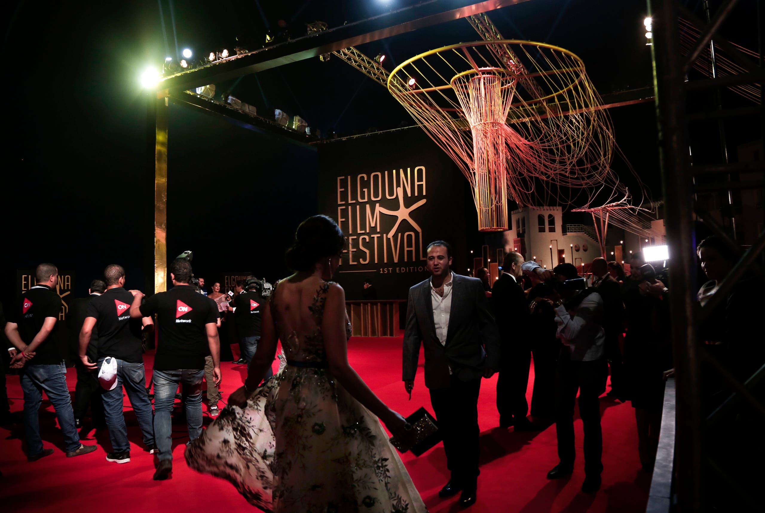 People walk on the red carpet during the first International El Gouna Film Festival, in the Red Sea resort of el-Gouna, Egypt, Friday, Sept. 22, 2017. (AP)
