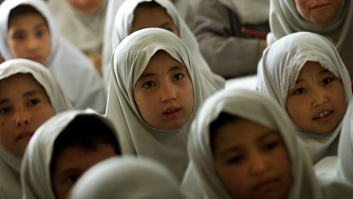 Afghan girls listen to their volunteer teacher in a humble school for unregistered refugees outside the southern Iranian town of Mashad, near the border with Afghanistan June 20, 2001. (File photo: Reuters)