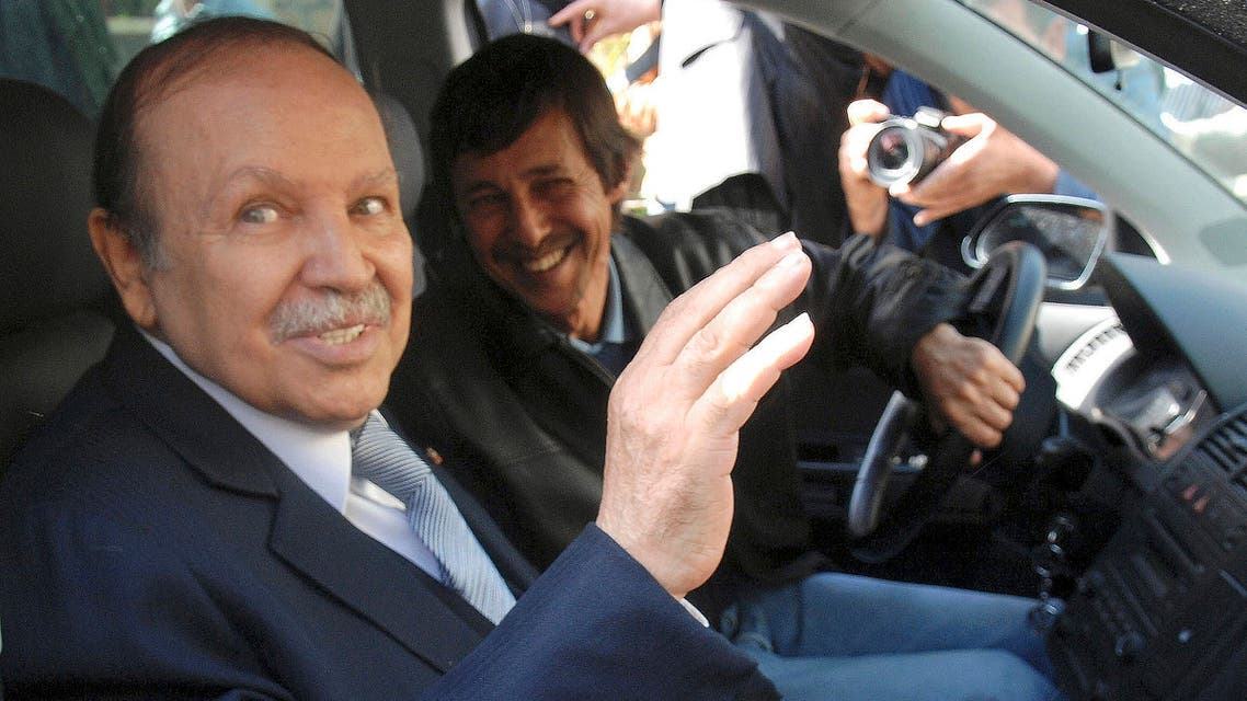 This Friday April 10, 2009 file photo shows Algerian President Abdelaziz Bouteflika, left, and his brother Said Bouteflika arrives at his campaign headquarters in the Hydra district of Algiers. (AP)