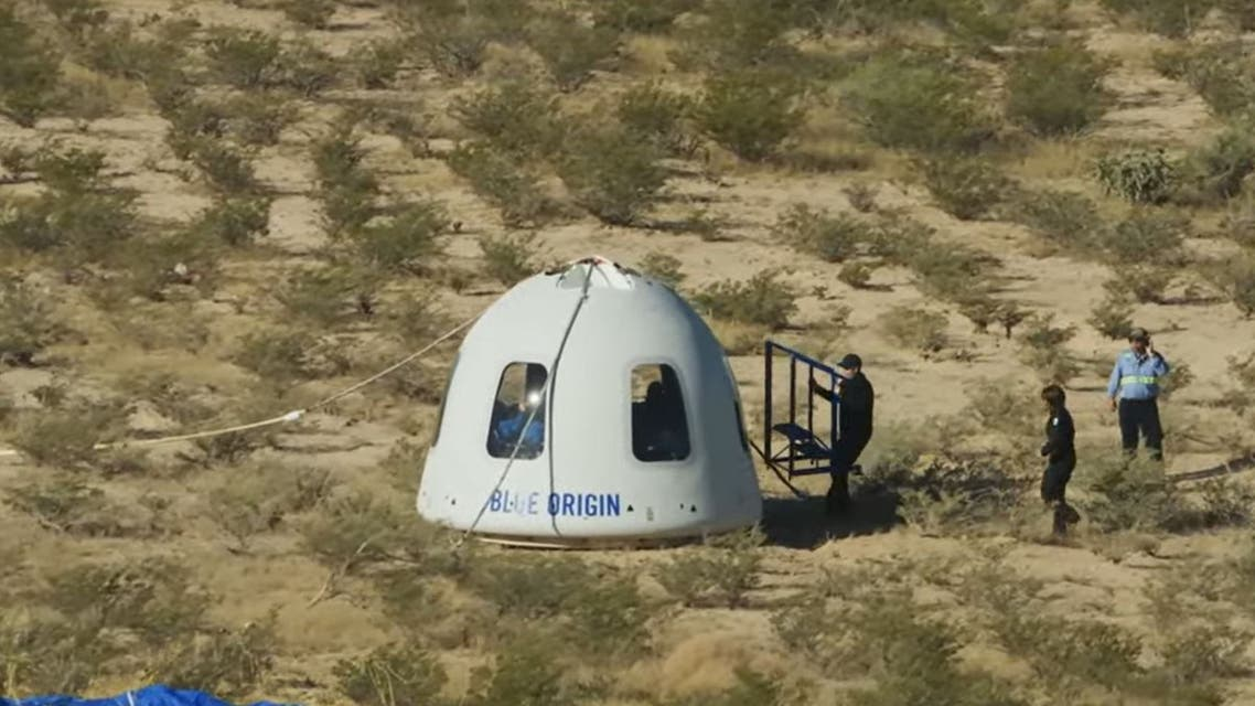In this still image taken from a Blue Origin video, recovery crews reach the New Shepard NS-18 mission capsule after landing on October 13, 2021, in the West Texas region, 25 miles (40kms) north of Van Horn. Star Trek actor William Shatner went to where no 90-year-old has gone on Blue Origin's second crewed mission. He was joined on the New Shepard rocket by Blue Origin's Vice President of Mission & Flight Operations, Audrey Powers; Planet Labs co-founder, Chris Boshuizen, and Medidata Solutions Co-Founder, Glen de Vries. (Photo by Jose ROMERO / various sources / AFP) / RESTRICTED TO EDITORIAL USE - MANDATORY CREDIT AFP PHOTO / BLUE ORIGIN - NO MARKETING - NO ADVERTISING CAMPAIGNS - DISTRIBUTED AS A SERVICE TO CLIENTS - RESTRICTED TO EDITORIAL USE - MANDATORY CREDIT AFP PHOTO / Blue Origin - NO MARKETING - NO ADVERTISING CAMPAIGNS - DISTRIBUTED AS A SERVICE TO CLIENTS