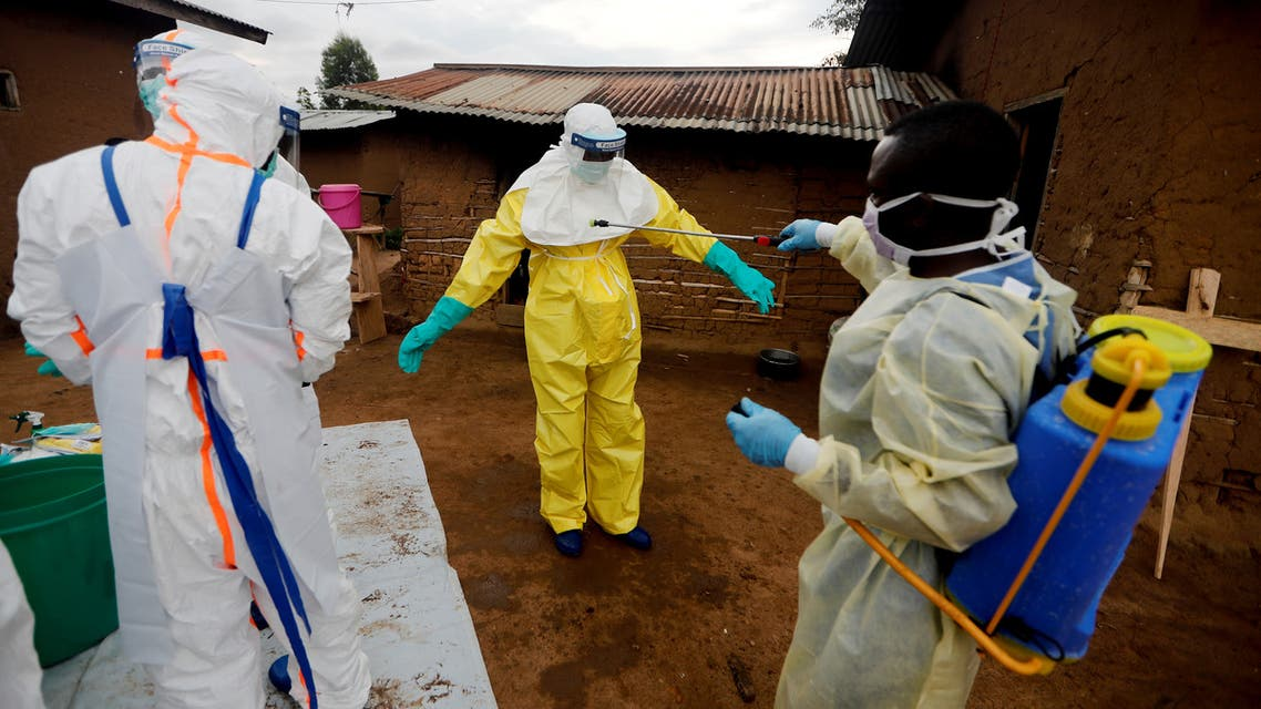 File photo of a healthcare worker who volunteered in the Ebola response, decontaminating his colleague after he entered the house of 85-year-old woman, suspected of dying of Ebola, in the eastern Congolese town of Beni in the Democratic Republic of Congo, October 8, 2019. (Reuters)