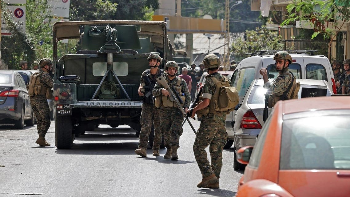Lebanese Army soldiers take a position in the area of Tayouneh, in the southern suburb of the capital Beirut on October 14, 2021, after clashes following a demonstration by supporters of Hezbollah and the Amal movement. (AFP)