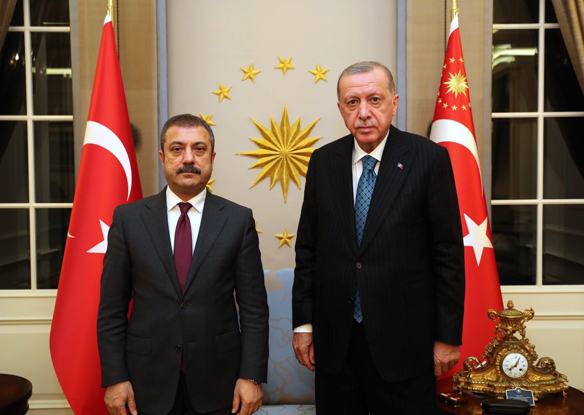 Turkey Central Bank governor Sahap Kavcioglu (left) with President Recep Erdogan (right) at the presidential mansion in Ankara. (Turkish presidency via Twitter)
