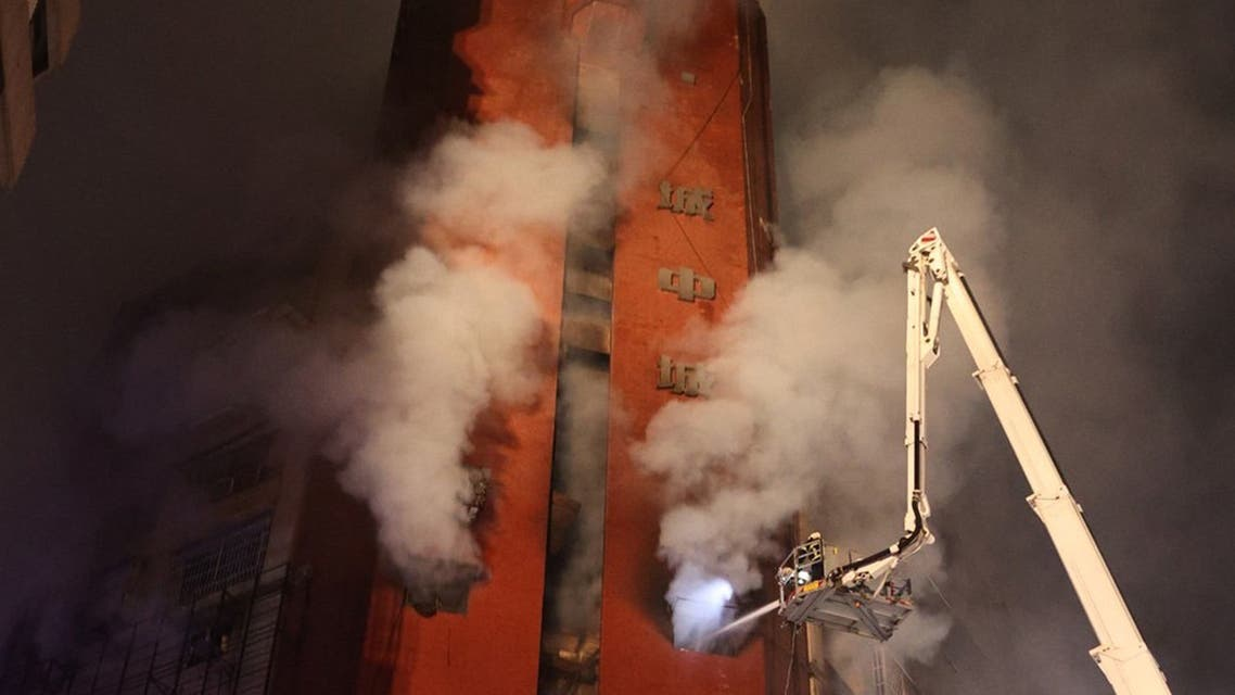 This picture taken and released by Taiwan's Central News Agency (CNA) shows smoke rising from an overnight fire that tore through a building in the southern Taiwanese city of Kaohsiung, killing at least 46 people and injuring dozens of others. (AFP)