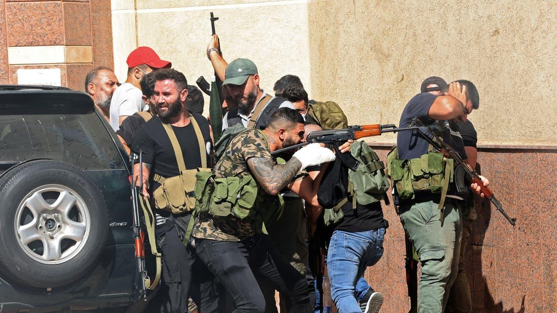 عناصر من حزب الله وحركة أمل في طيونة خلال اشتباكات بيروت  - 14 اكتوبر 2021 - فرانس برس