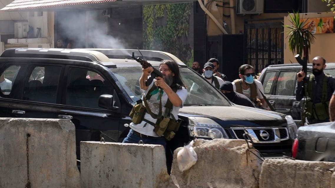 Supporters of a Shiite group allied with Hezbollah fire weapons during armed clashes, Oct. 14, 2021. (AP)