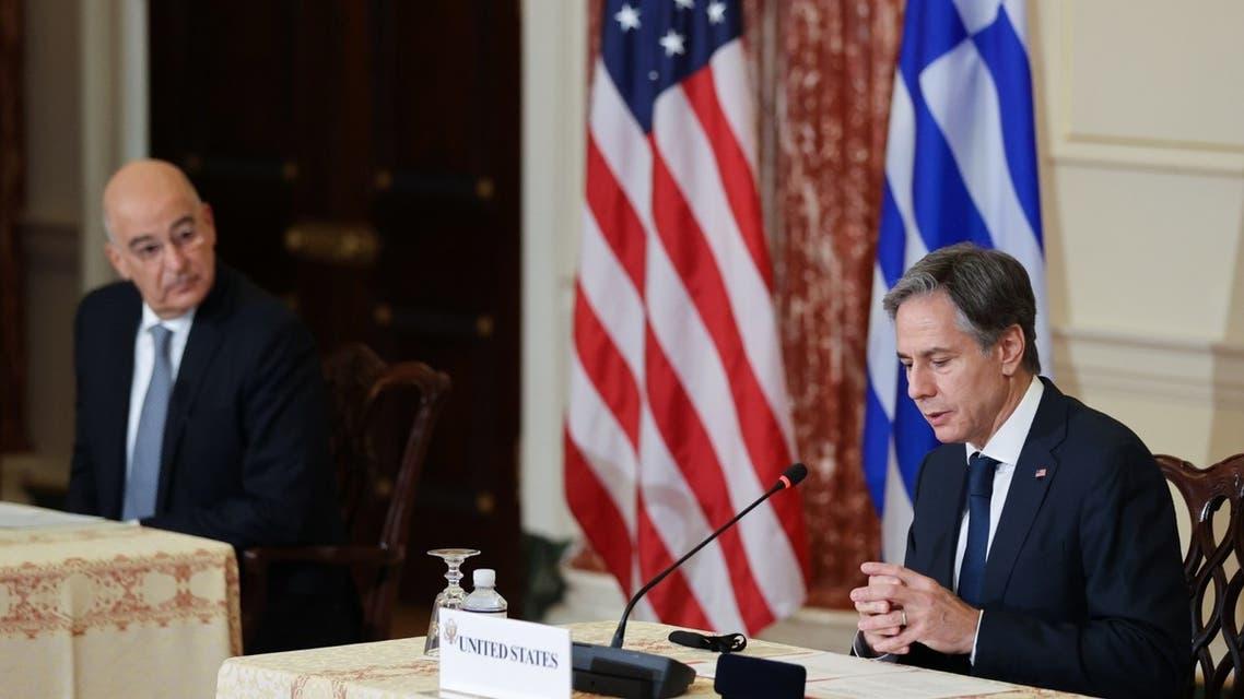 وزير الخارجية الأميركي ونظيره اليونان (فرانس برس)
