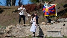 Protestors with Tibetan flag disrupt flame lighting for Beijing Winter Games