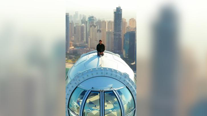 Dubai Crown Prince sips coffee on top of Ain Dubai wheel pod on opening day