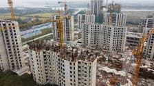 China's debt-ridden Evergrande averts default, resumes work on more than 10 projects