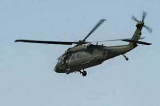 مقتل 5 أمريكيين بتحطم هليكوبتر وتفجير جسر رئيسي ببغداد