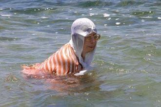 Egyptian women switch veil with bikini