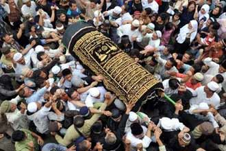 Emotions boil over as Bali bombers buried