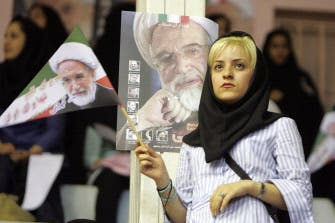 Supporters of Iran election rivals clash