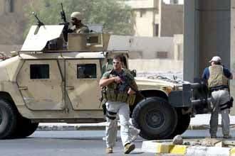 Three  US contractors freed in Iraq murder case