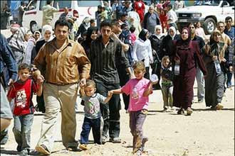 Iraqi refugees in Syria worry as govt's dispute