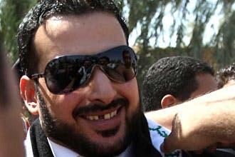 الصحافي العراقي الذي رشق بوش بحذائه يطالب المالكي بالاعتذار