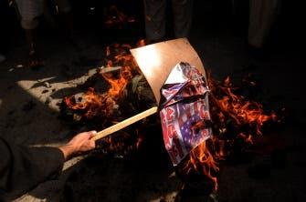 Afghans accuse US troops of burning Quran
