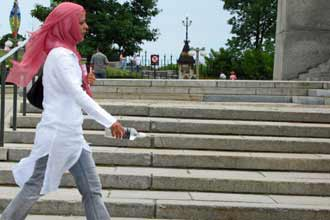 American faces jail for pulling woman's headscarf