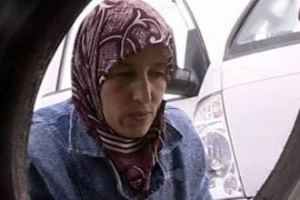 Syrian woman breaks social norms with car wash