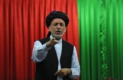 Afghan President Karzai earns $525 a month