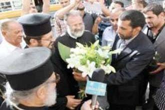 Jordanian Muslims plant flowers in church