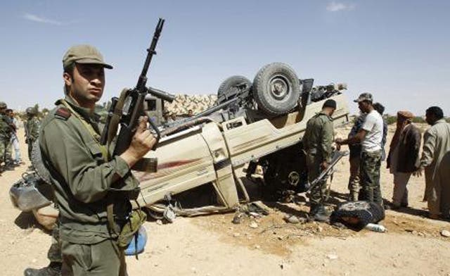 Libyan shells fall in Tunisia in new fighting between Qaddafi forces and rebels