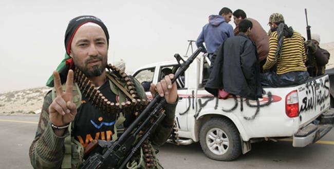 Rebels welcome ICC's arrest warrants for Qaddafi, as explosions rock Tripoli