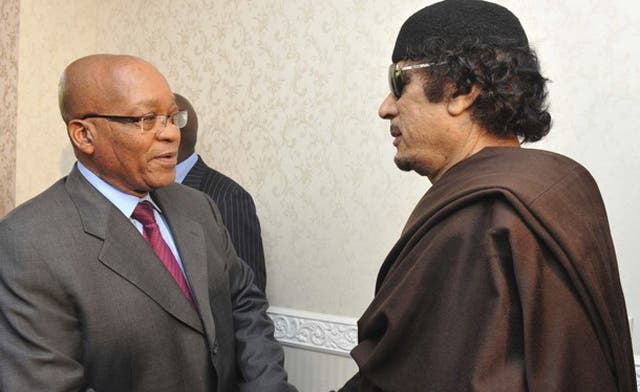 Qaddafi appears on TV greeting Zuma and has a French lawyer to his defense