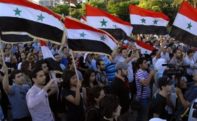 Protesters in Syria commerce capital Aleppo urge Assad exit
