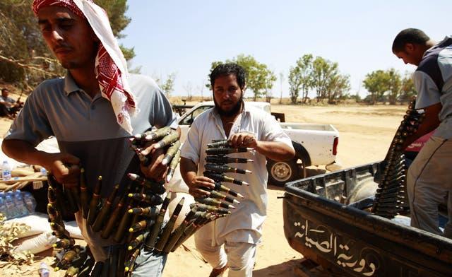 Libya rebels lose three men in Brega assault
