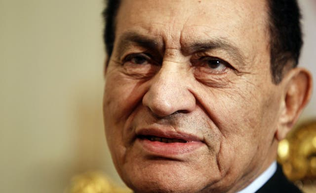 Mubarak to be placed in a metal cage during trial in auditorium seating hundreds