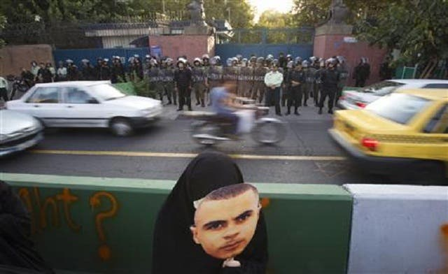 Iranians protest over UK police 'savagery' in riots