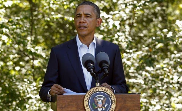 "Obama says Qaddafi era over, promises US aid for ""democratic"" Libya"