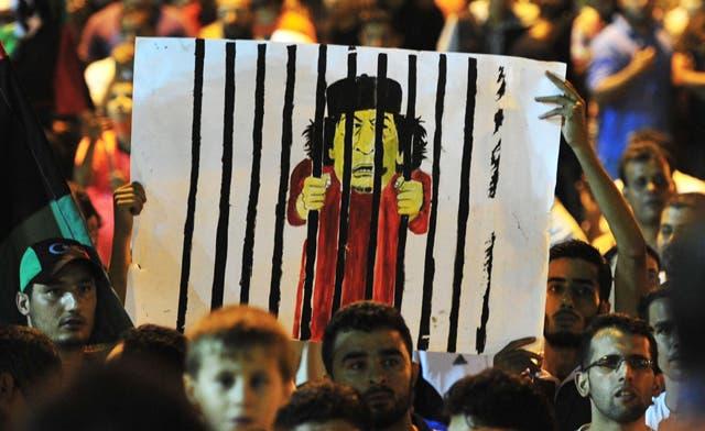 Libyan rebels celebrate victory in Tripoli, reports say Qaddafi still in capital