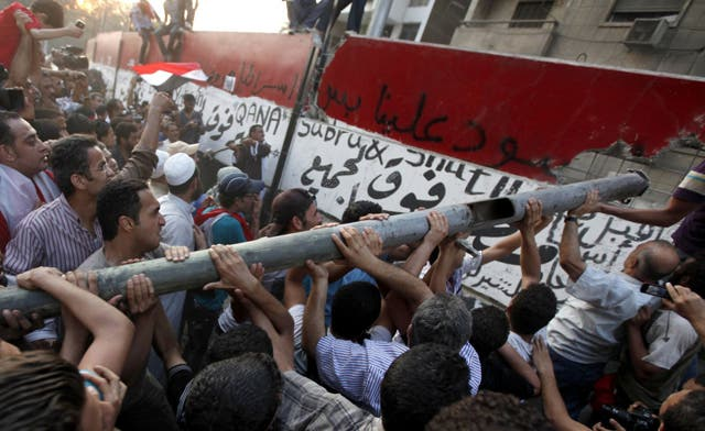 Egypt's protesters break into Israeli embassy in Cairo and toss confidential documents
