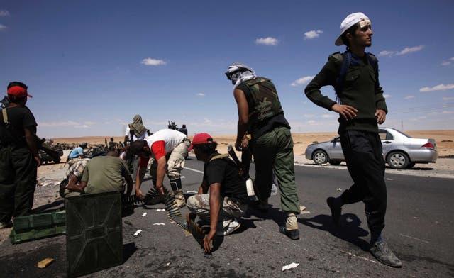 Infighting between Libyan rebels kills 12; Qaddafi's spy chief arrested