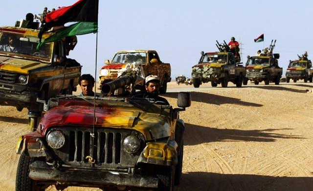 Libya's revolutionary fighters enter Qaddafi hometown Sirte, fight his loyalists