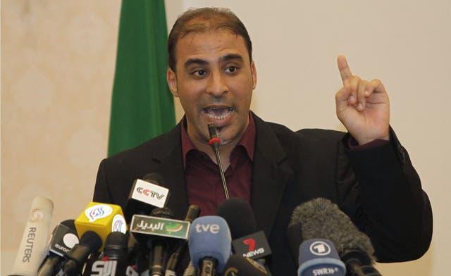 Qaddafi spokesman Mussa Ibrahim captured outside Sirte 'dressed as a woman'