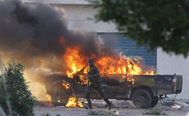NTC says Qaddafi's son is still at large; battles in Sirte and Bani Walid continue