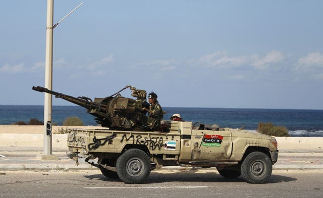 U.S. weighed cyber attack in Libya war; NTC still fighting Qaddafi troops in Sirte