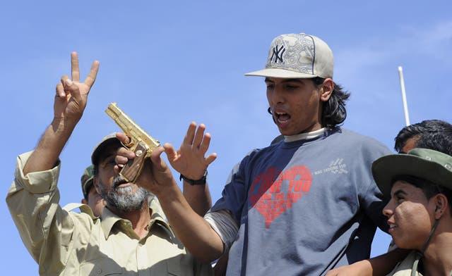 The 18-year-old man who killed Libya's Muammar Qaddafi