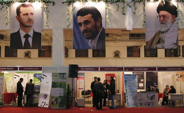 Iran's Ahmadinejad condemns Syria for 'killings and massacre'