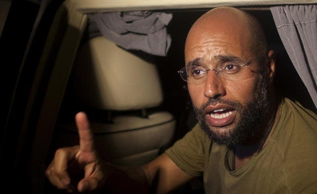 In first statement after his father's death, Saif al-Islam Qaddafi vows to fight on