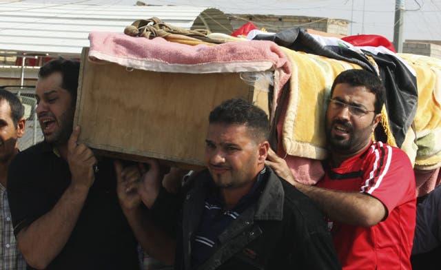 Dozens die in surge of violence in Iraq