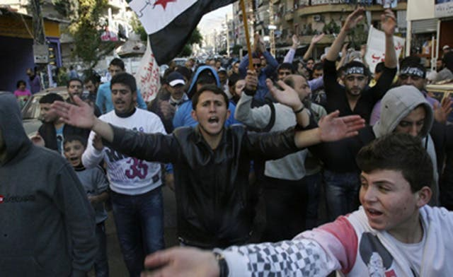 Syrian dissidents to get arms, volunteers from Libya to fight Assad's regime