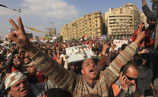 Egypt awaits delayed poll results as Tahrir Square protesters commemorate 'martyrs'