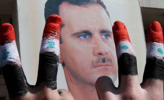 Alawites in Turkish border city dread Assad's fall