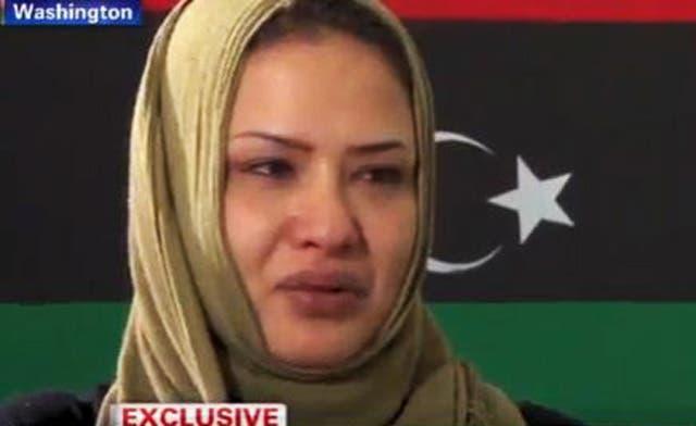 Libya's Eman al-Obeidi speaks to Western media after her arrival in the U.S.